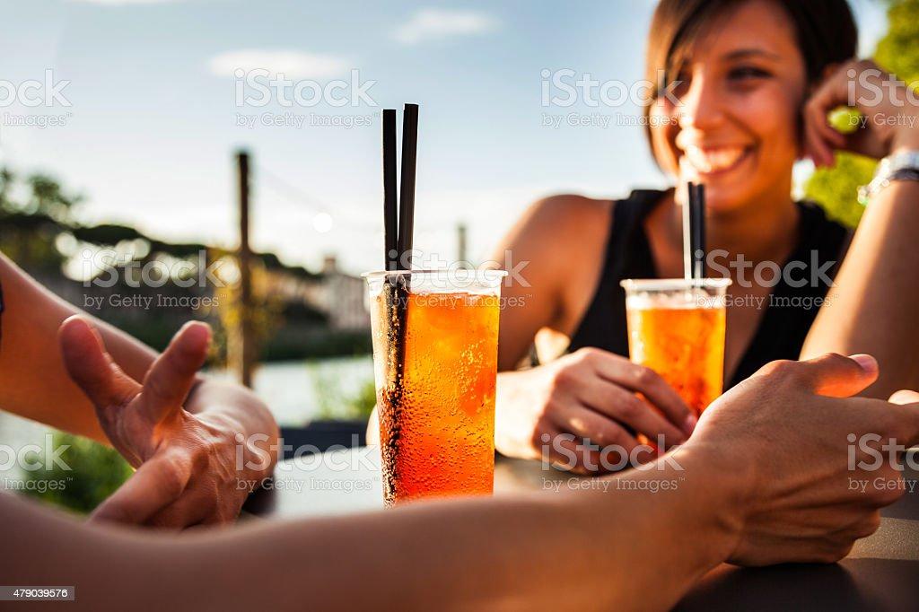Woman drinking enjoying a summer happy hour stock photo