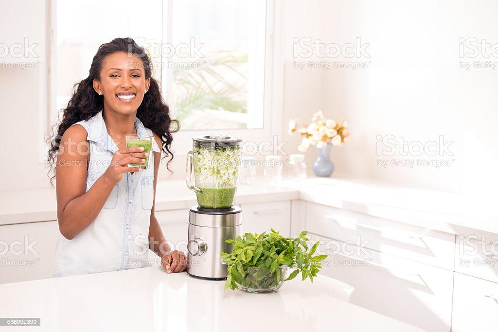 Woman drinking fresh lemonade. stock photo