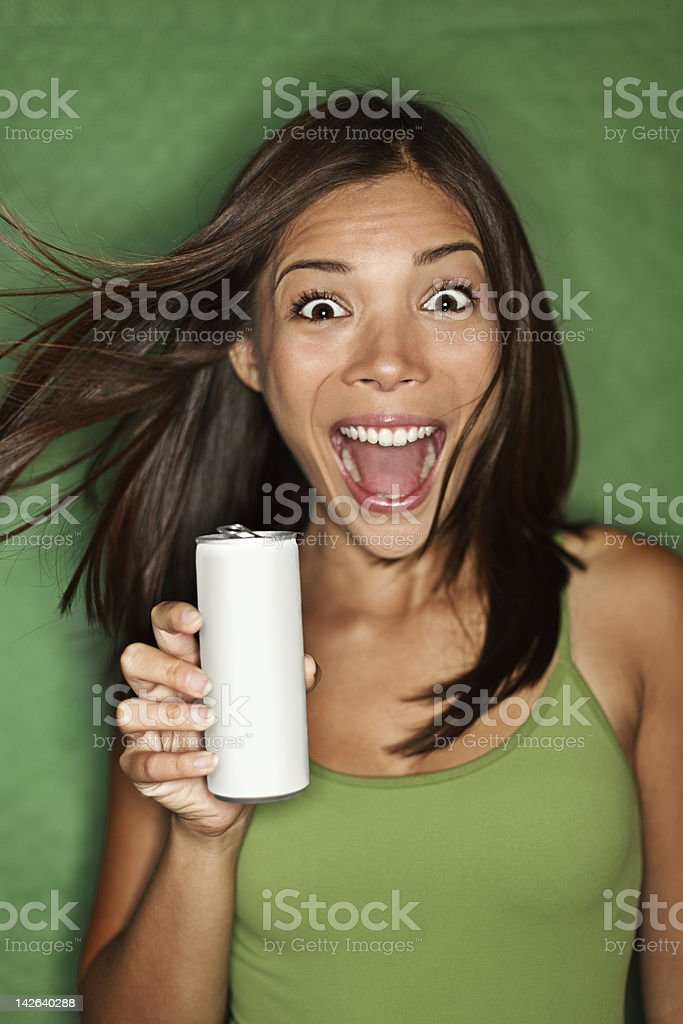 Woman drinking from blank can stock photo