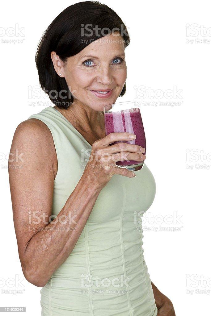 Woman drinking fruit smoothie royalty-free stock photo