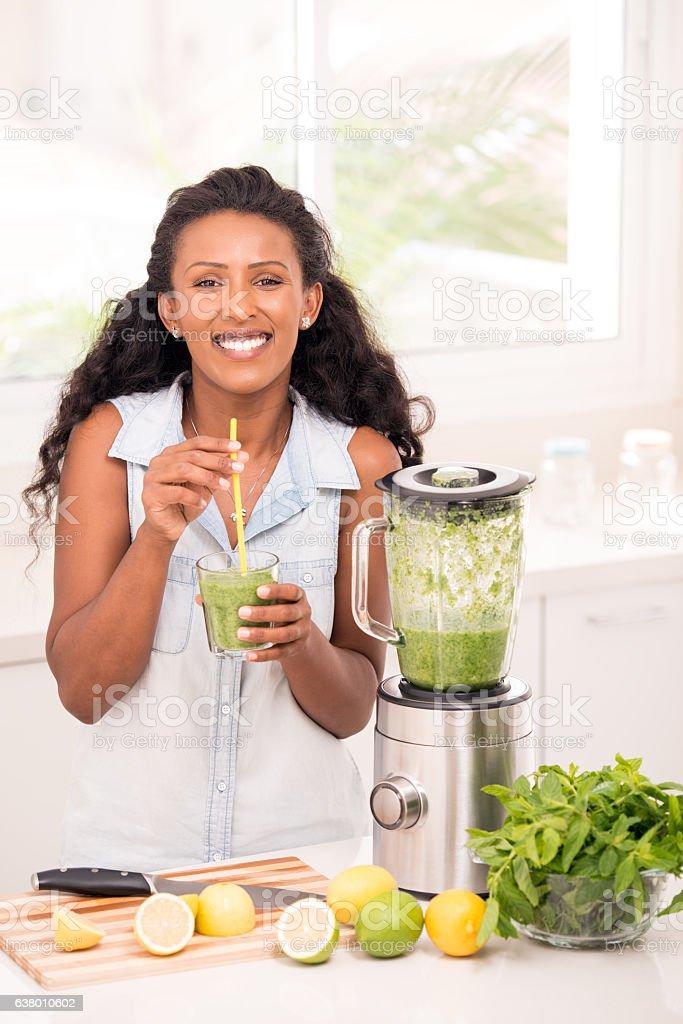 Woman drinking homemade lemonade. stock photo