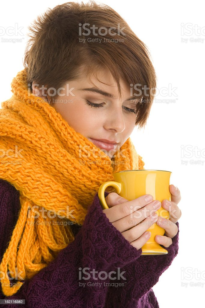Woman drinking hot beverage royalty-free stock photo