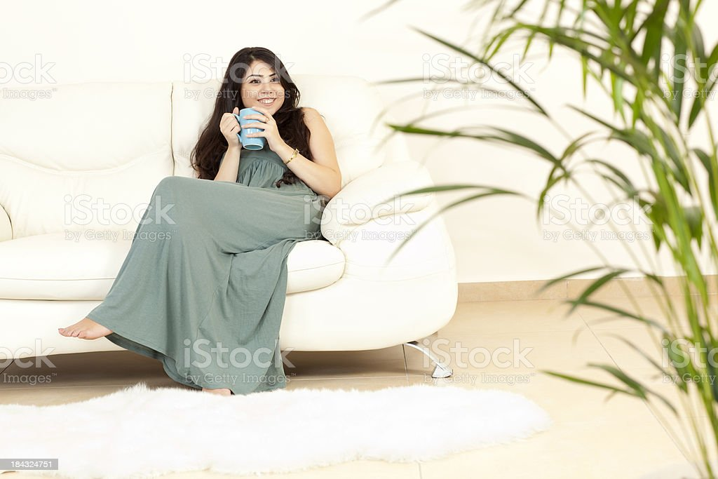 Woman drinking hot drink at guest room. royalty-free stock photo