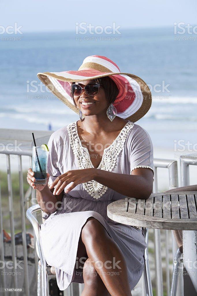 Woman drinking on beach terrace royalty-free stock photo