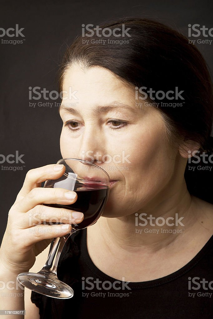 Woman drinking red wine royalty-free stock photo
