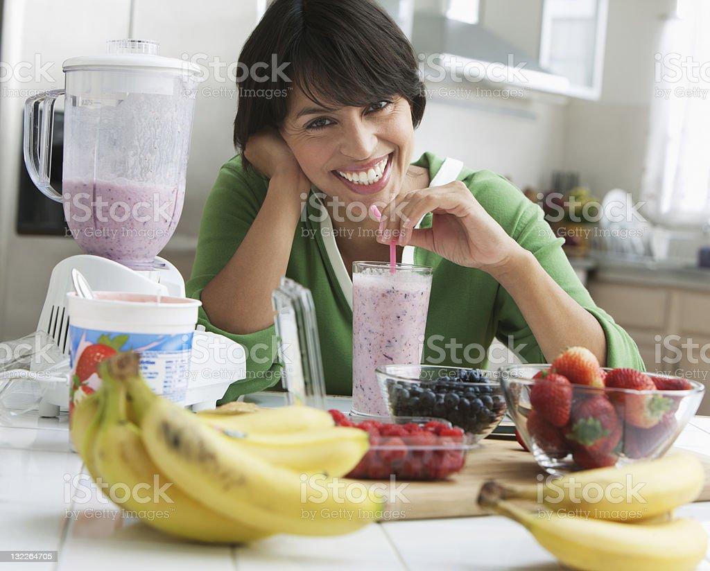 Woman drinking smoothie stock photo