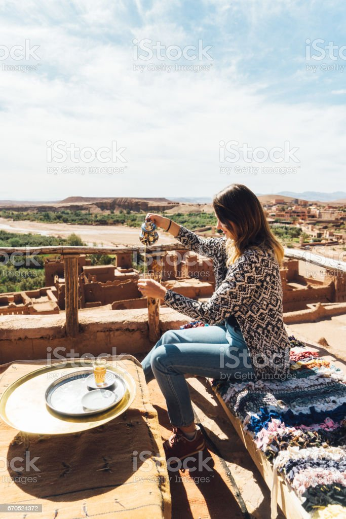 Woman drinking tea in Ait Ben Haddou Casbah stock photo