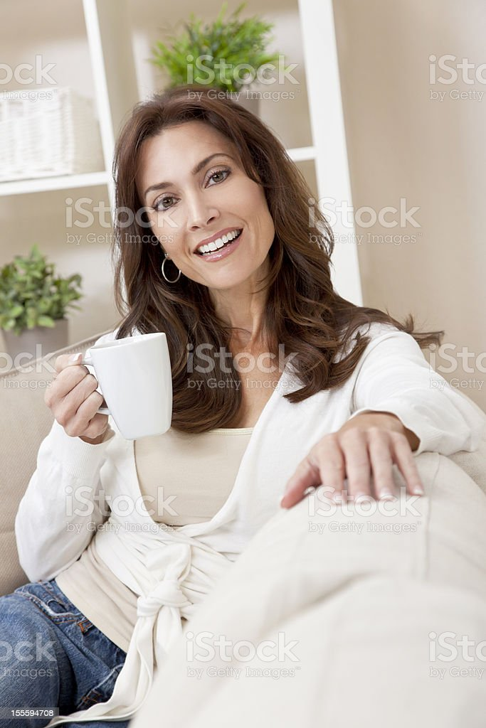 Woman Drinking Tea or Coffee at Home royalty-free stock photo