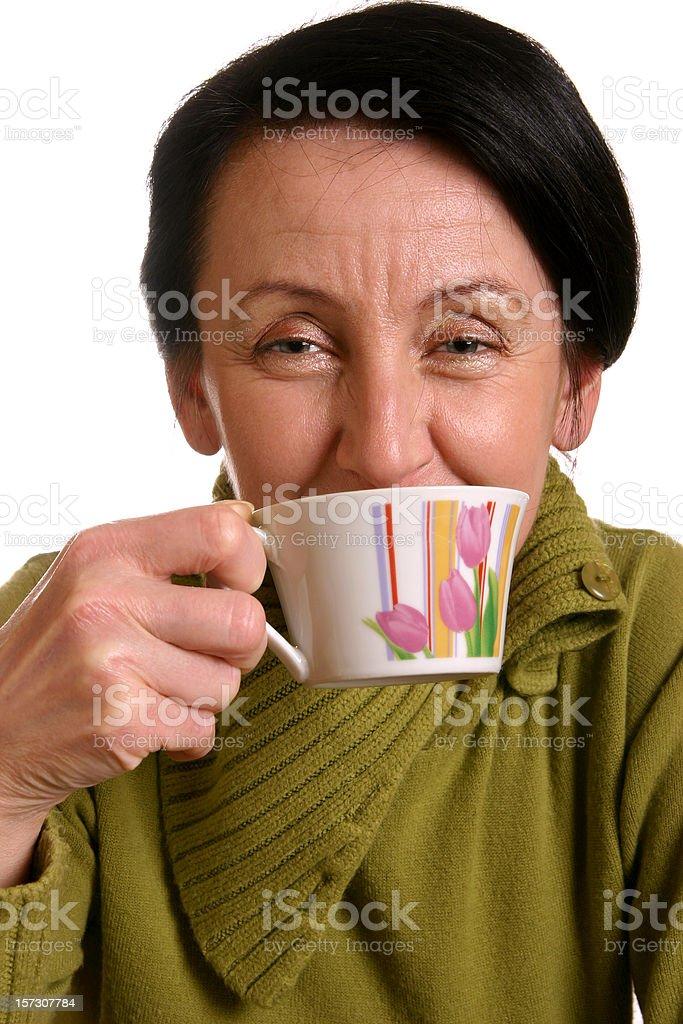 Woman drinking tea stock photo