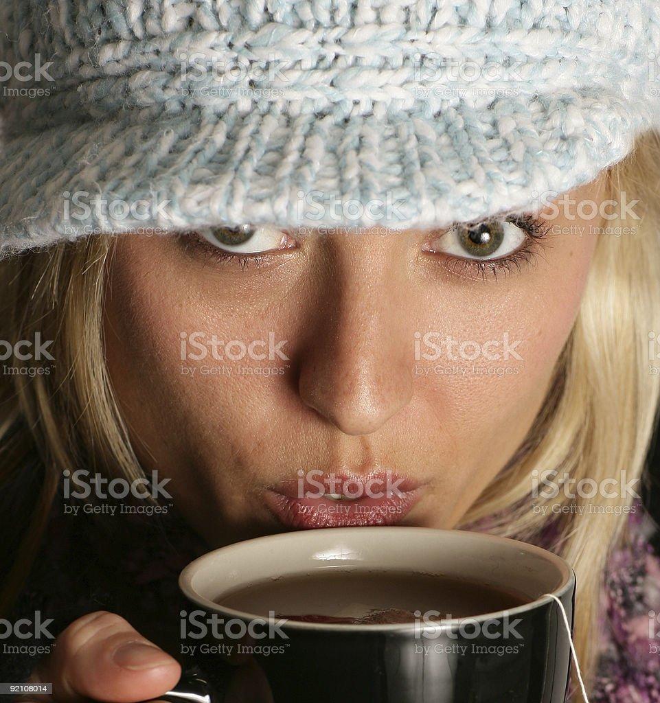 Woman drinking warm beverage royalty-free stock photo