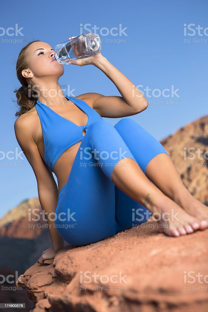 Woman drinking water bottle royalty-free stock photo