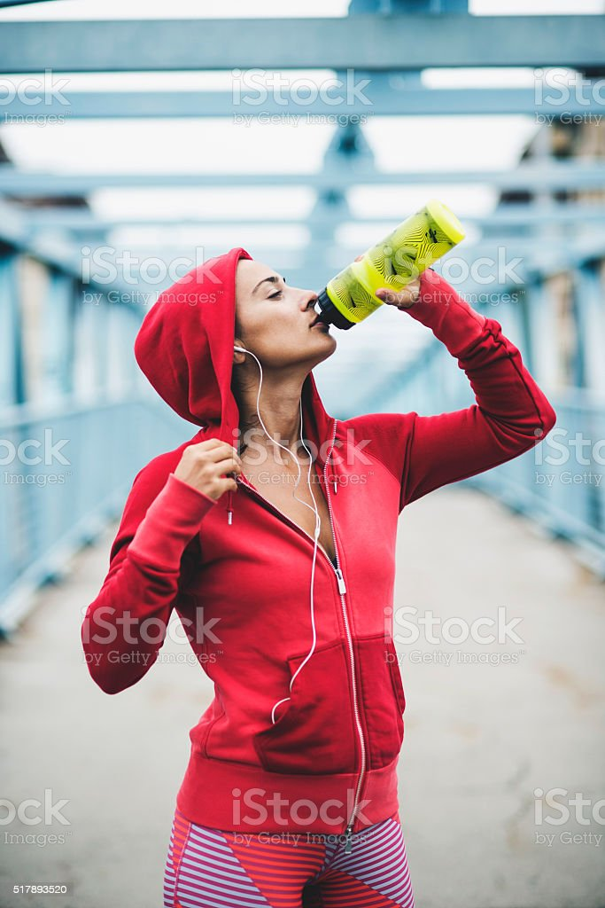 Woman drinking water during workout stock photo