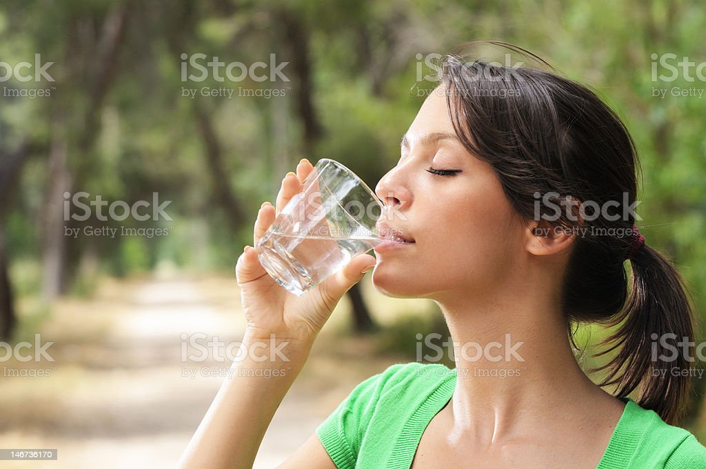 woman drinking water glass royalty-free stock photo