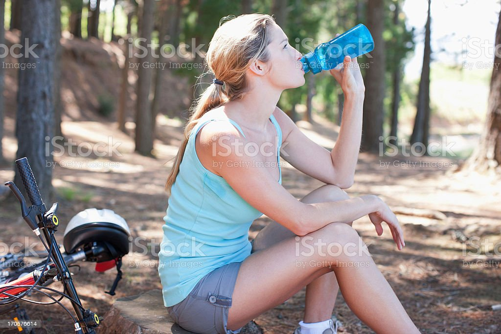 Woman drinking water in forest royalty-free stock photo
