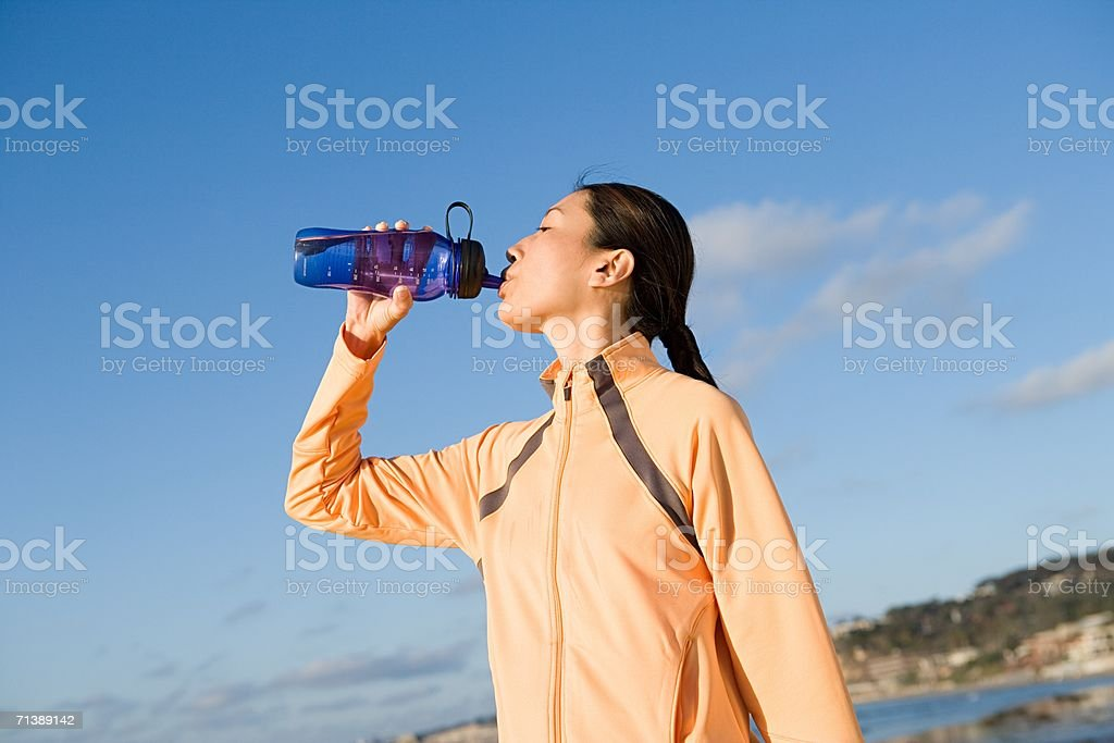 Woman drinking water royalty-free stock photo