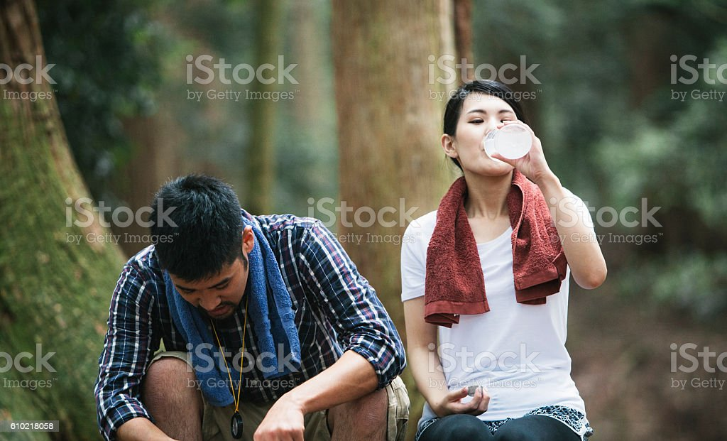 Woman Drinking Water while Hiking stock photo