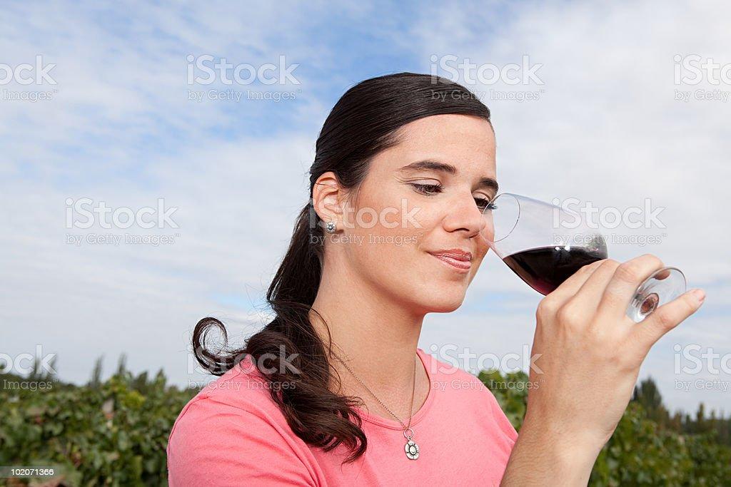 Woman drinking wine in vineyard royalty-free stock photo