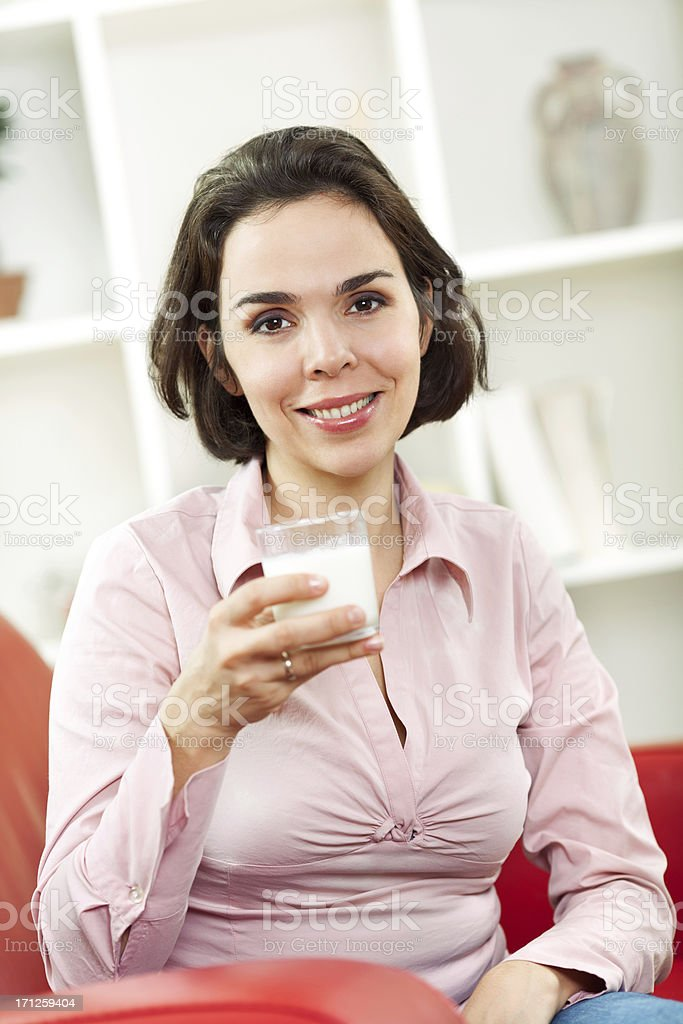 Woman drinks milk royalty-free stock photo