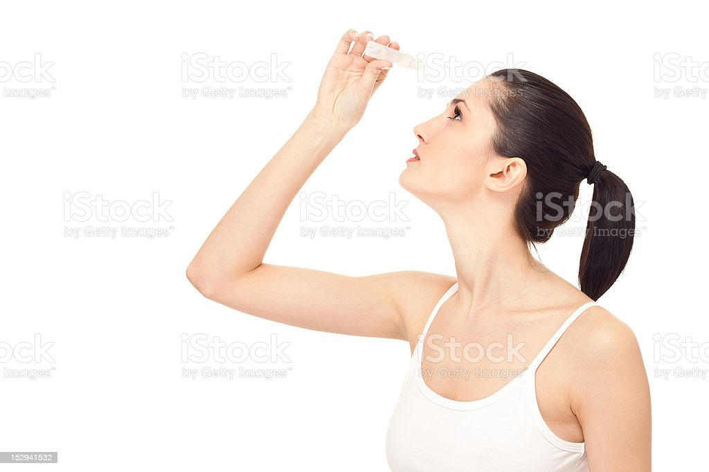 woman dripping eye with eyes drops stock photo