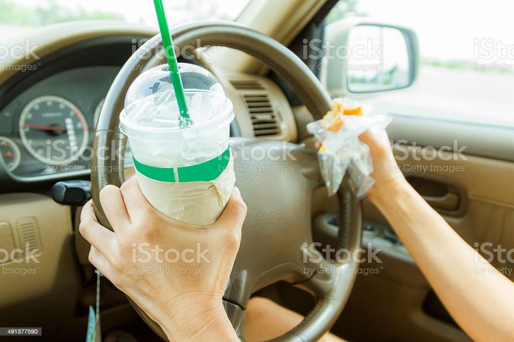 Woman driver driving a car on the road. stock photo