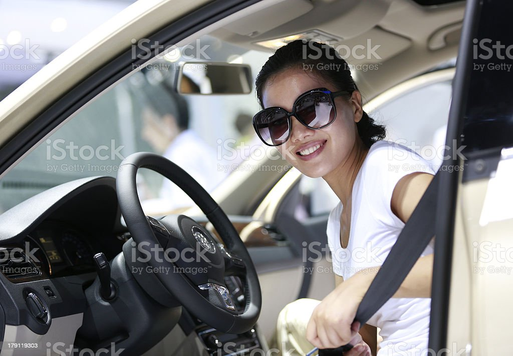 woman driver fasten secuirty belt royalty-free stock photo