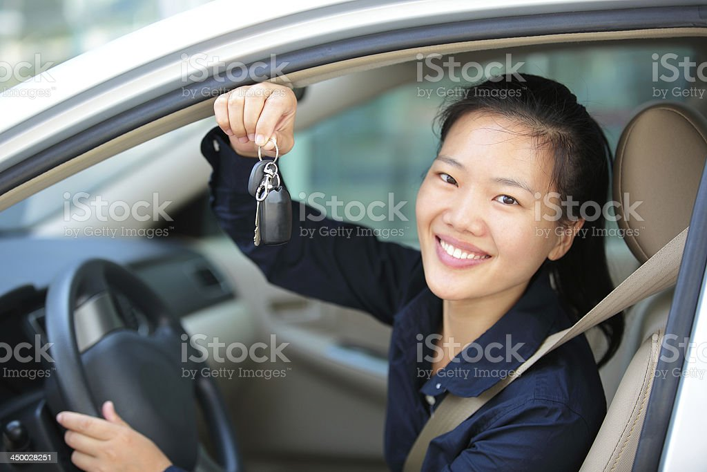 woman driver happy with her first car stock photo