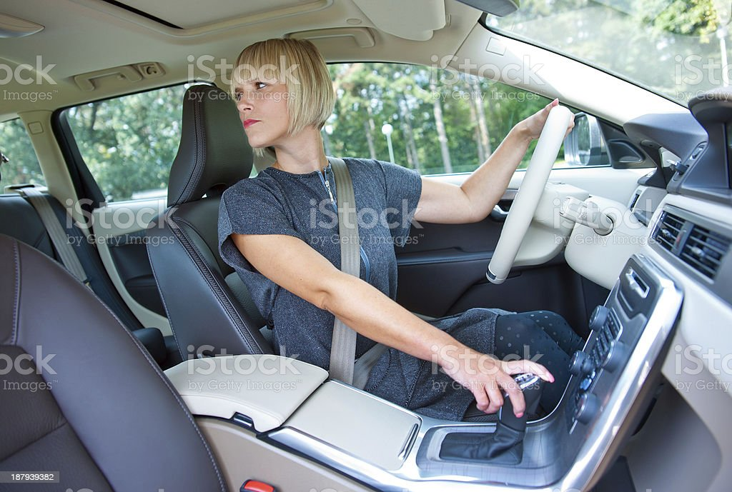 woman driver parking her car stock photo