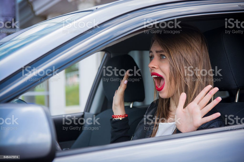 Woman driver scared shocked before crash stock photo