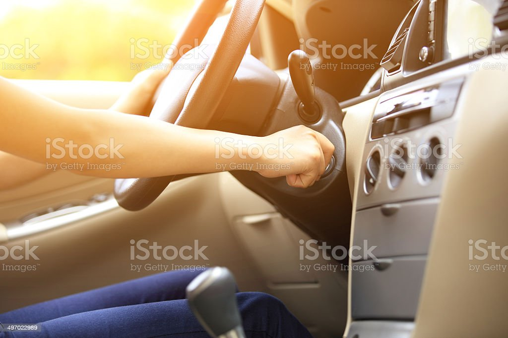 woman driver starting the car stock photo