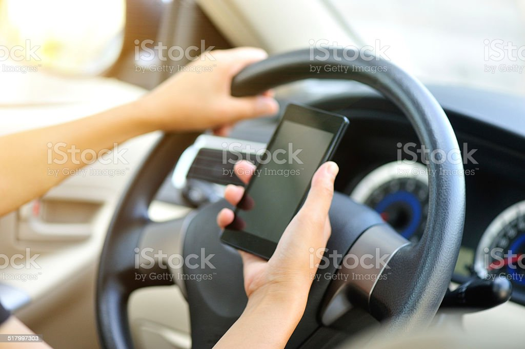 woman driver use her cell phone in car stock photo