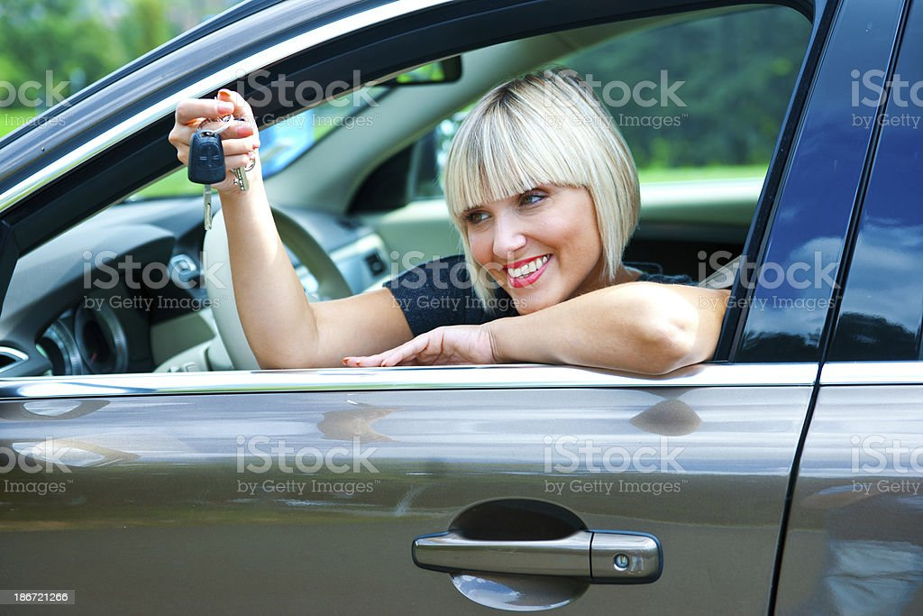 woman driver with car key royalty-free stock photo