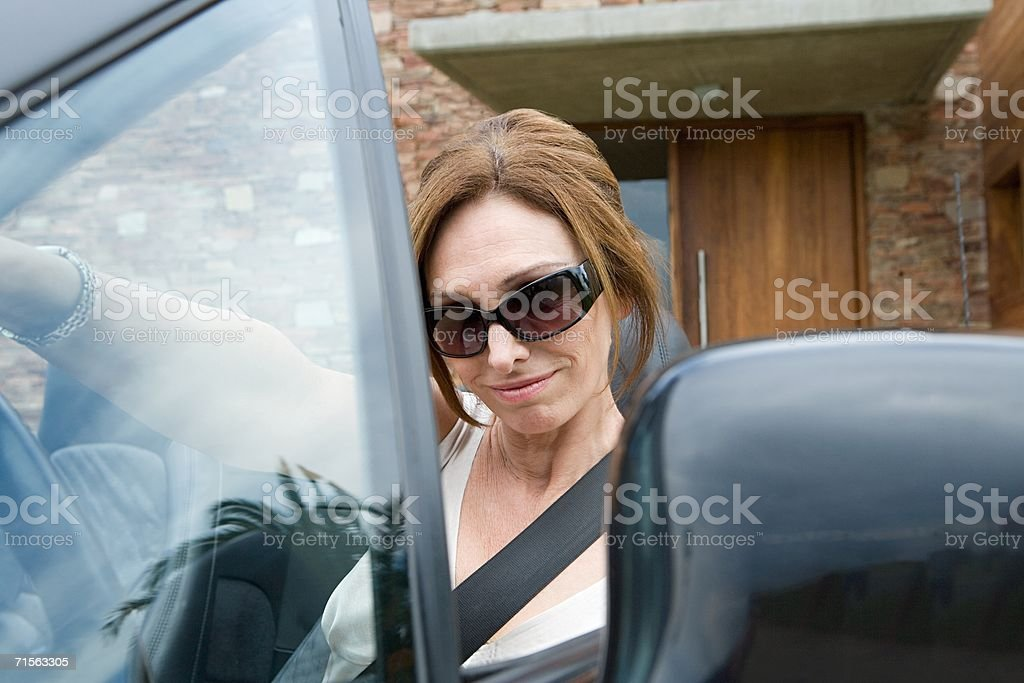Woman driving a convertible royalty-free stock photo