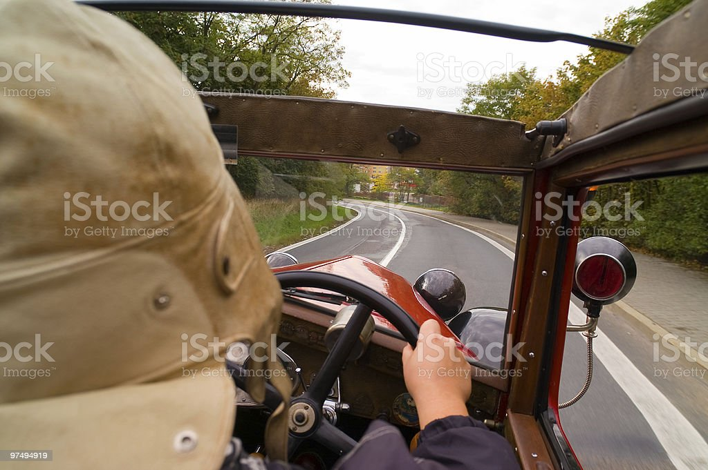 Woman driving an old car stock photo