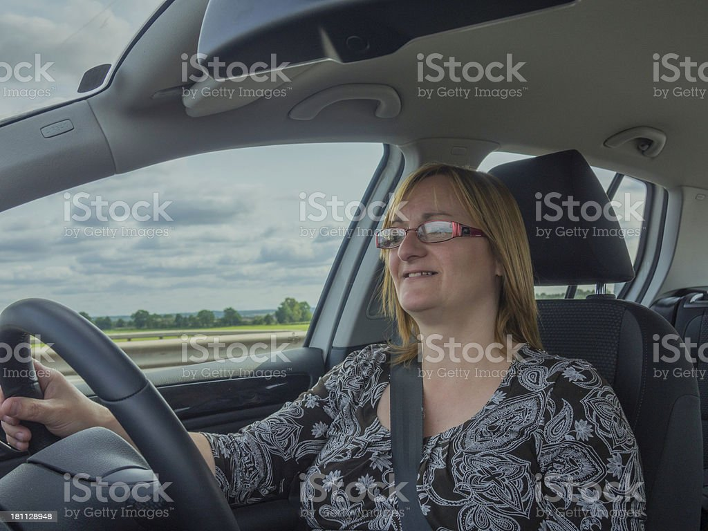 Woman driving car on a UK motorway. royalty-free stock photo