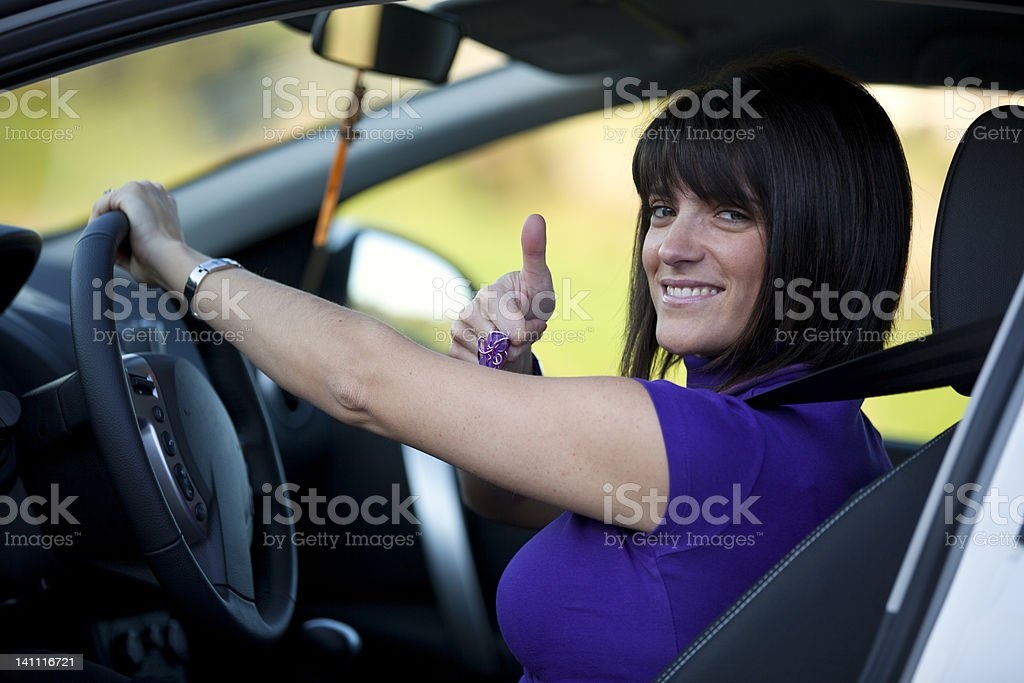 Woman driving her new car royalty-free stock photo