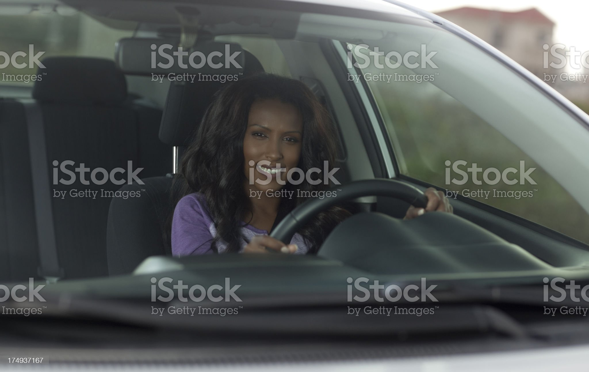 Woman driving in her new car royalty-free stock photo