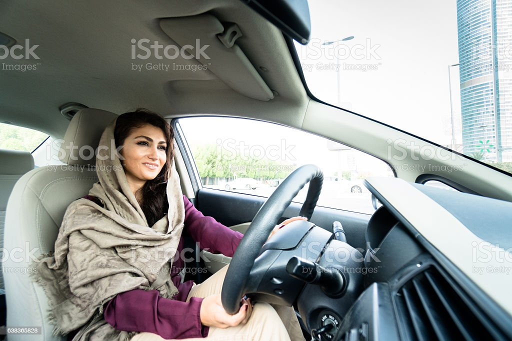 woman driving the car in abu dhabi stock photo