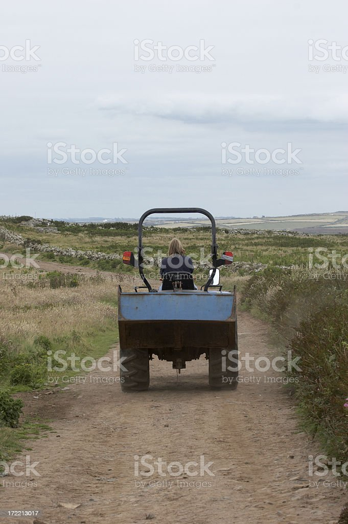 Woman driving tractor royalty-free stock photo