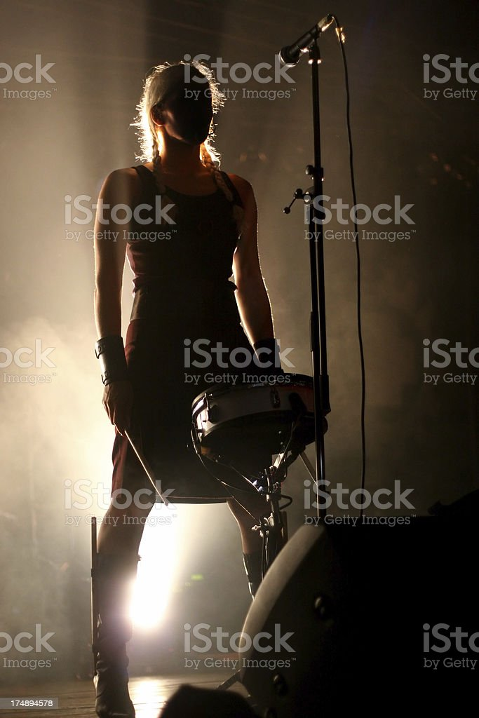Woman drumming on stage royalty-free stock photo