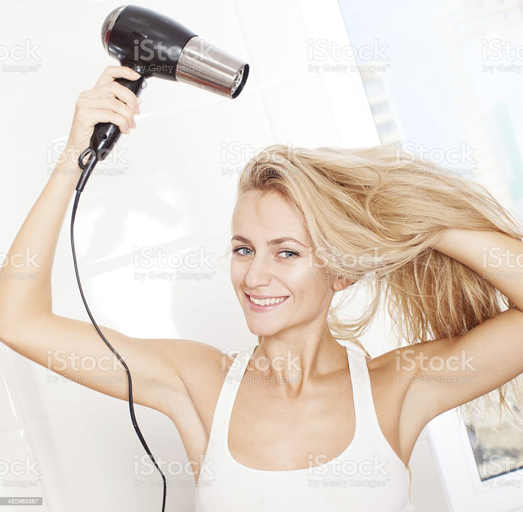 Woman dry hair stock photo