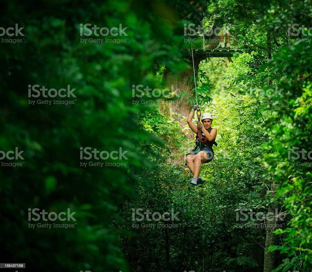 woman during a Canopy Tour in costa rica stock photo