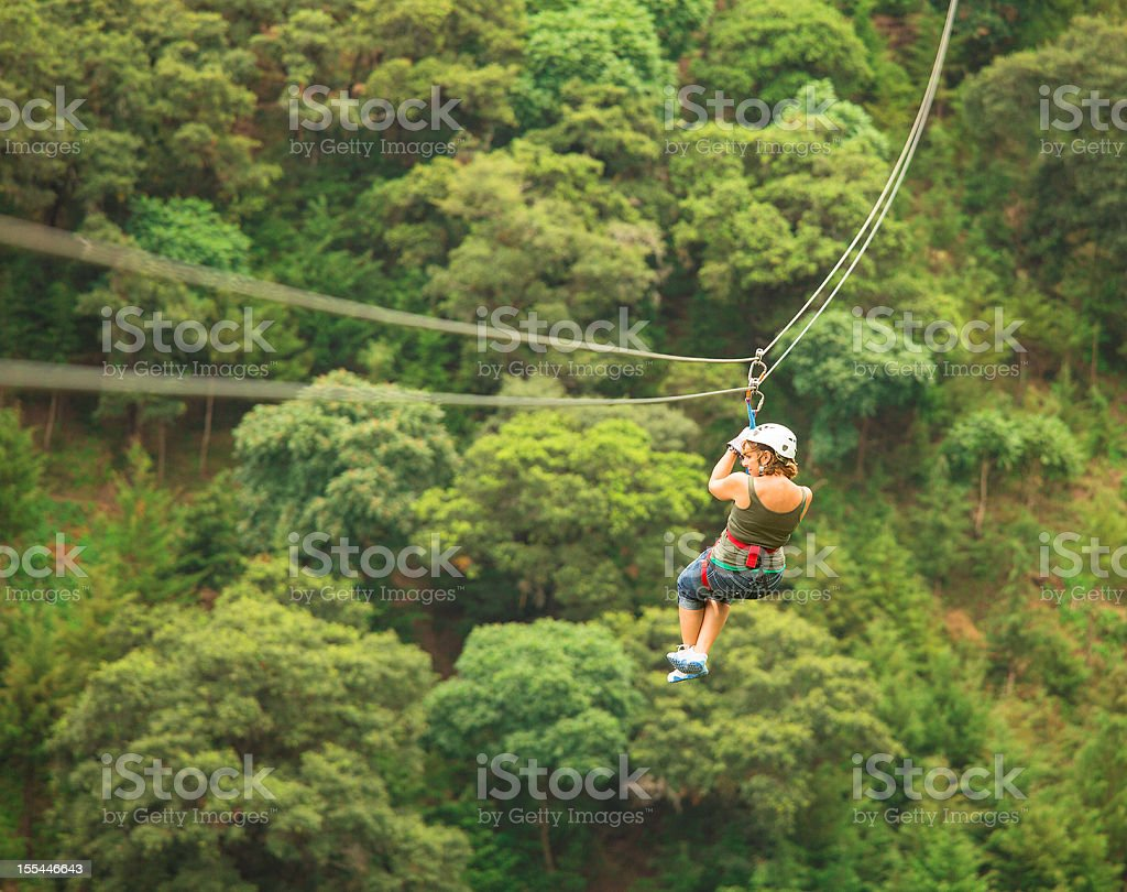 woman during a Canopy Tour in Guatemala stock photo