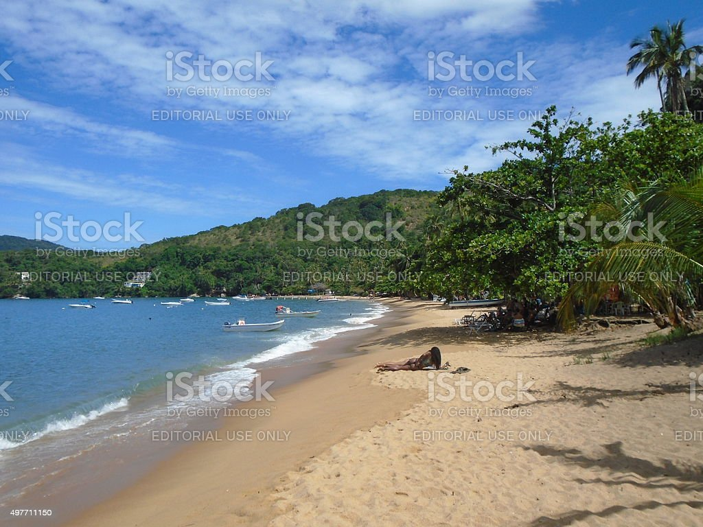 Woman during a sunbathing in Brazil. stock photo