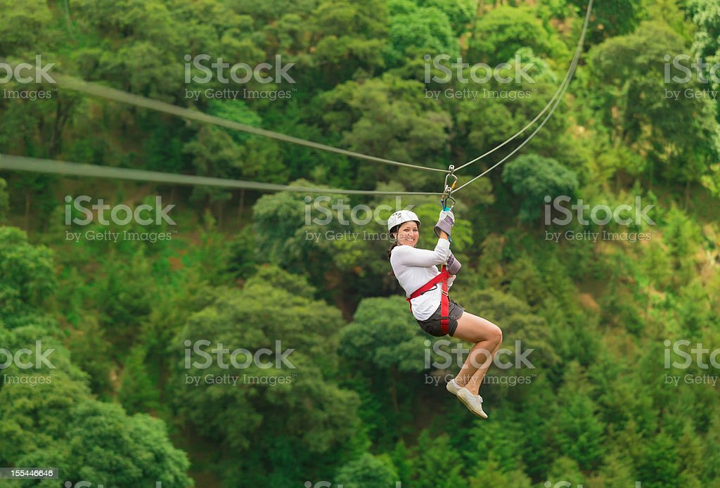 woman during a zip-line Tour in Guatemala stock photo