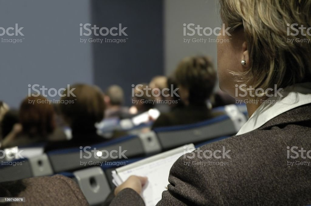 Woman during conference royalty-free stock photo