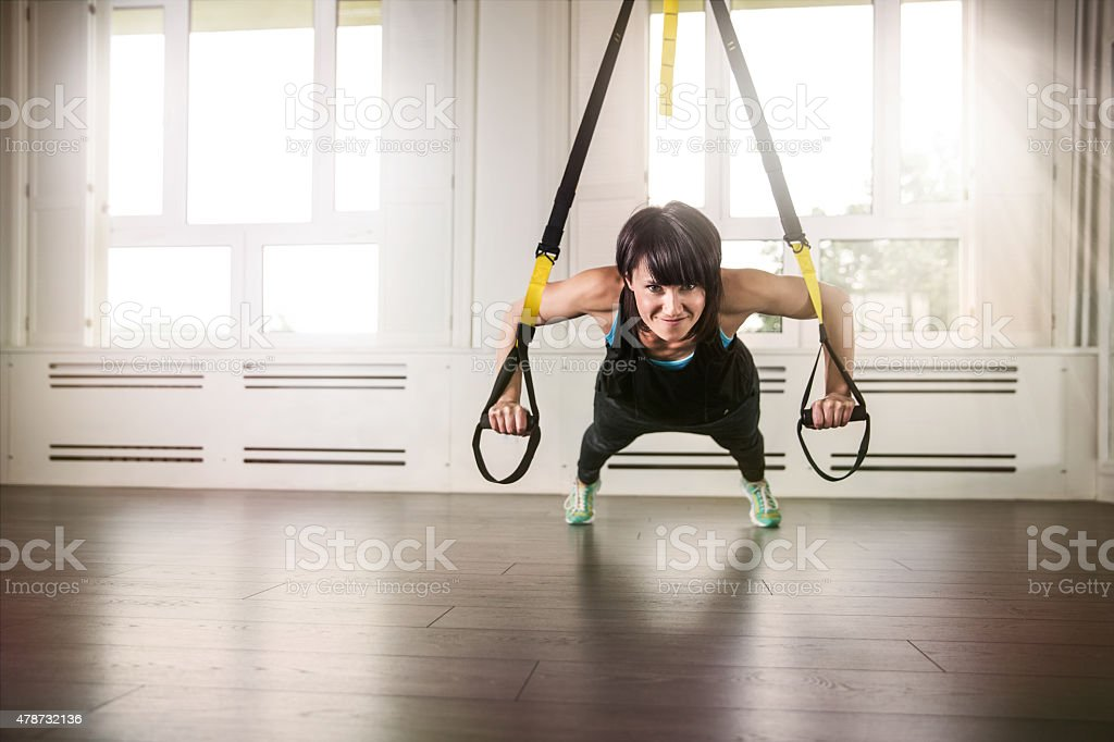 Woman during suspension training stock photo