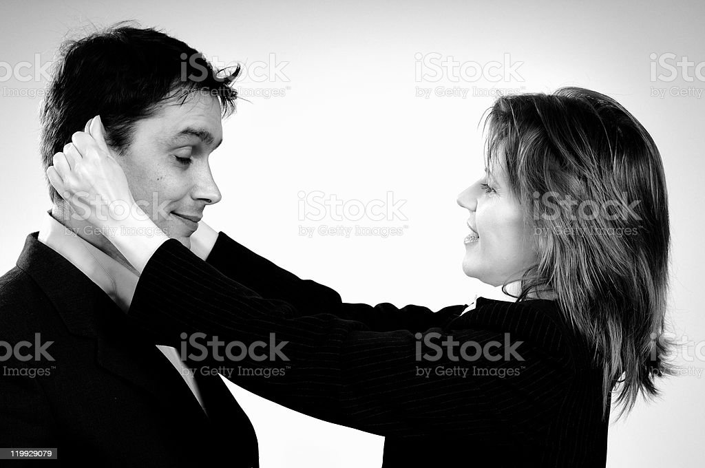 woman ear pulling her colleague stock photo