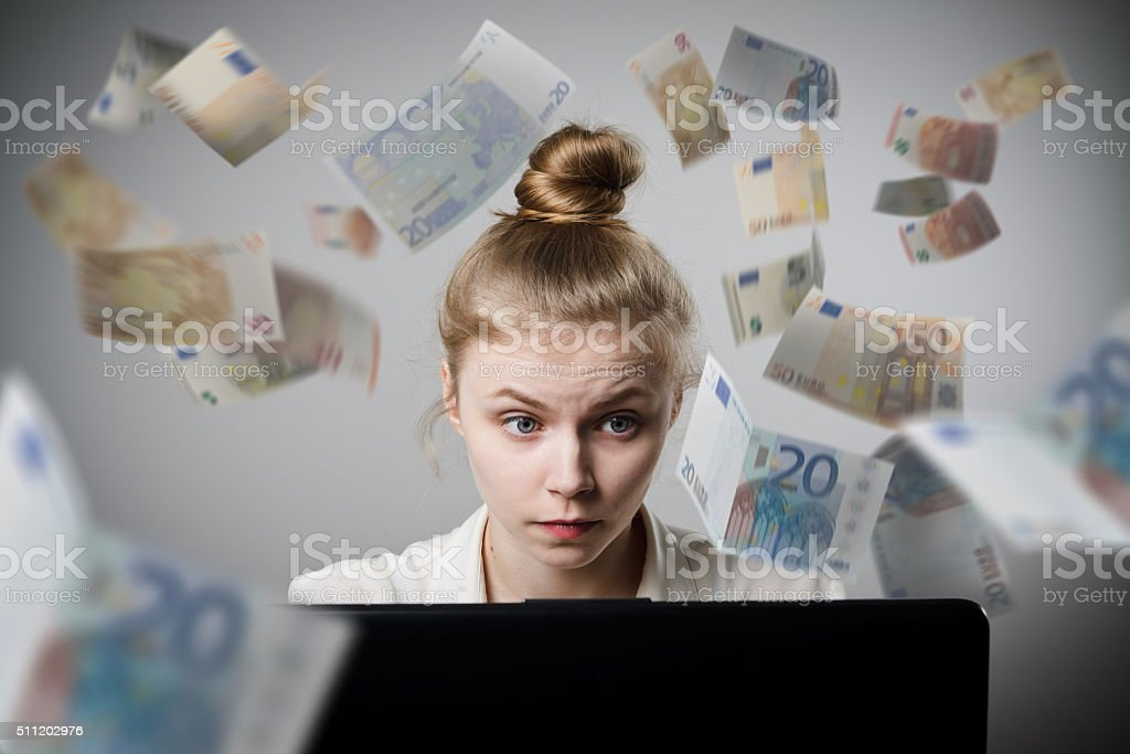 Woman earns Euro on the internet stock photo