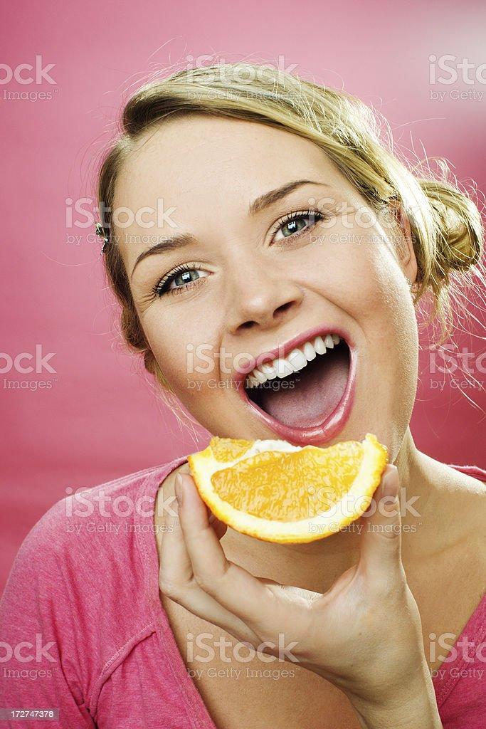 woman earting orange royalty-free stock photo