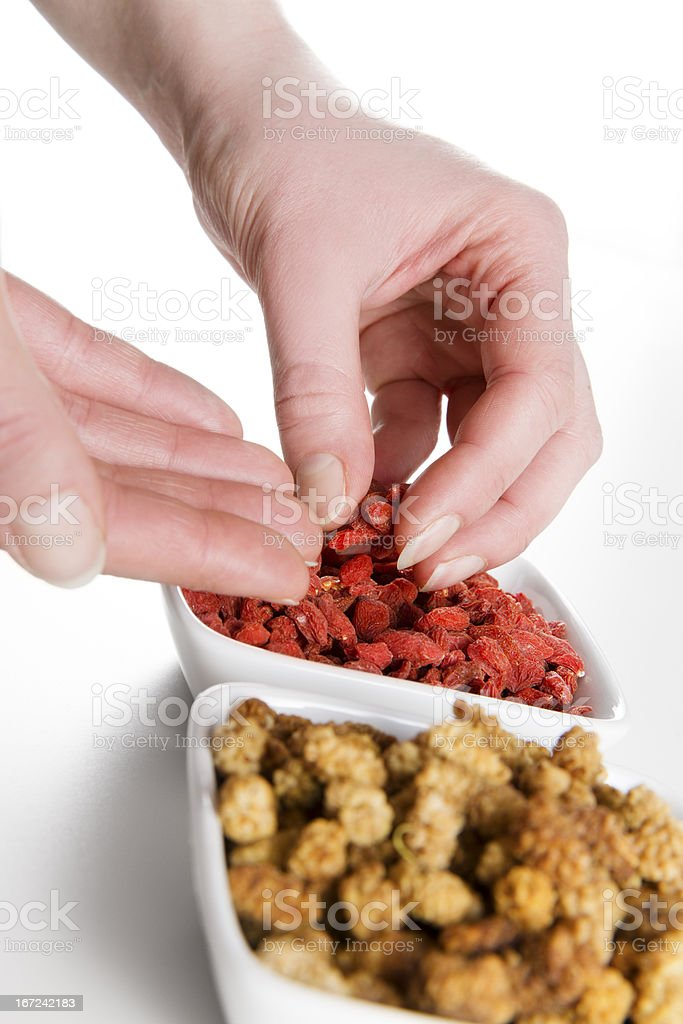 Woman eat Mulberries and Goji berries royalty-free stock photo